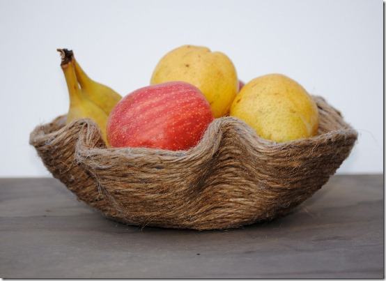 Fruit bowl made from a melted vinyl record wrapped in jute
