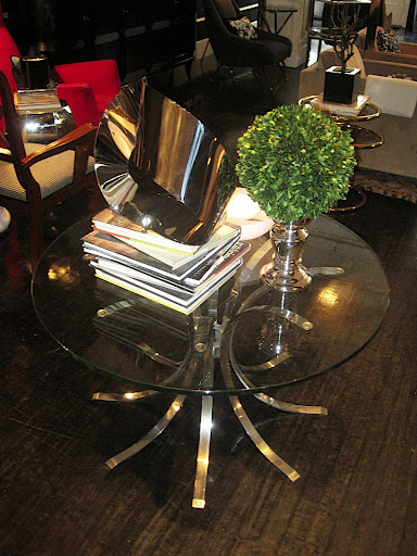 I am in the market for a side table and I really like a glass top.
