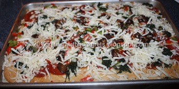 Easy Pizza - Gluten-Free   adding last cheese