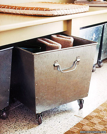 I love these rolling bins, they are perfect to go under an entryway bench and they are easy to rinse out and clean -- so putting shoes and boots in them would be a wonderful idea!