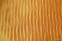 Ekskluzywna tkanina marszczona o bogatej teksturze. Na zasłony, poduszki, narzuty, dekoracje. Pomarańczowa, złota.