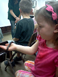 Holding a millipede at the Hidden Pond Nature Center. (May)