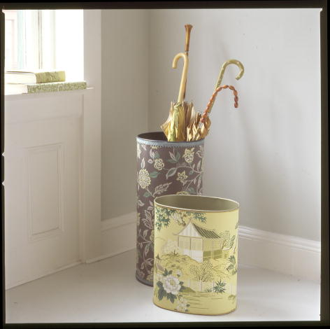 Dress up plain wastebaskets and umbrella stands with a covering of wallpaper. (marthastewart.com)