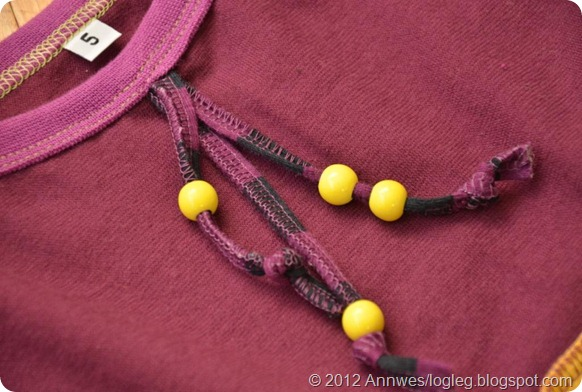 Dress decorated with beads on a jersey cord