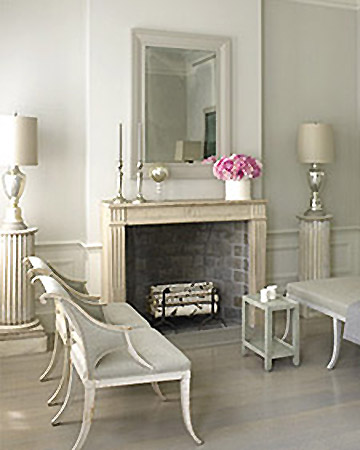 When he renovated his new apartment, Eric chose soothing shades of gray and made a decorative fireplace a focal point in the living room. The 19th-century French limestone piece was a gift from Martha Stewart.
