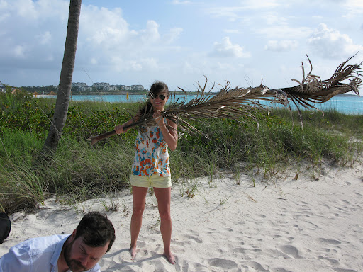 Here's Erin holding up a palm tree branch. We had to create some tropical shadows to make the shot just perfect.