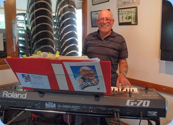 Treasurer, Laurie Conder playing his Roland G-70 keyboard. Photo courtesy of Dennis Lyons