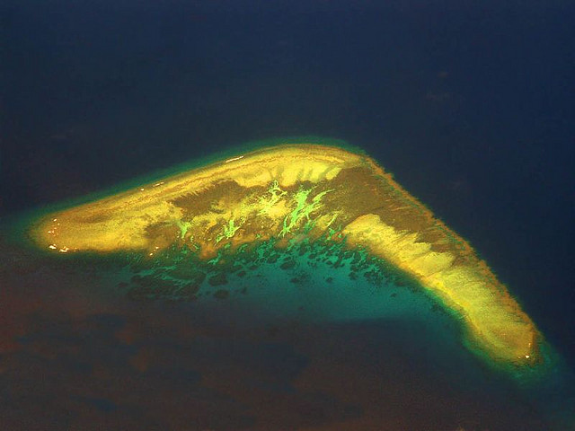 Aerial view of Boomerang Island, a coral atoll and part of the disputed Spratly Islands in South China Sea. China's economic boom has seen its coral reefs shrink by at least 80 percent over the past 30 years, a joint Australian study, with researchers describing 'grim' levels of damage and loss. Storm Crypt / Flickr