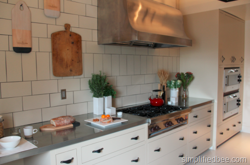 white_kitchen_tile_backsplash_zinc_counters