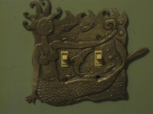 Even the switch plate had a mermaid on it.