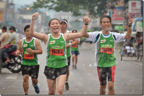 3 - Marathoners cross the finish line of the 37th National MILO Marathon 10-K distance in Cagayan de Oro.