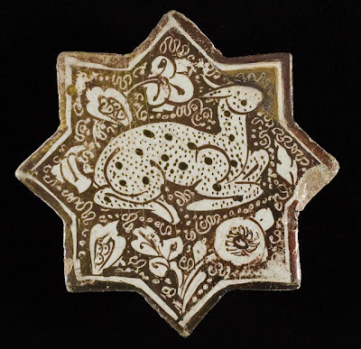Tile | Origin: Iran, Kashan | Period:  Early to mid-13th century | Collection: The Nasli M. Heeramaneck Collection, gift of Joan Palevsky (M.73.5.374) | Type: Ceramic; Architectural element, Fritware, overglaze luster-painted, Height: 4 1/2 in. (11.43 cm)