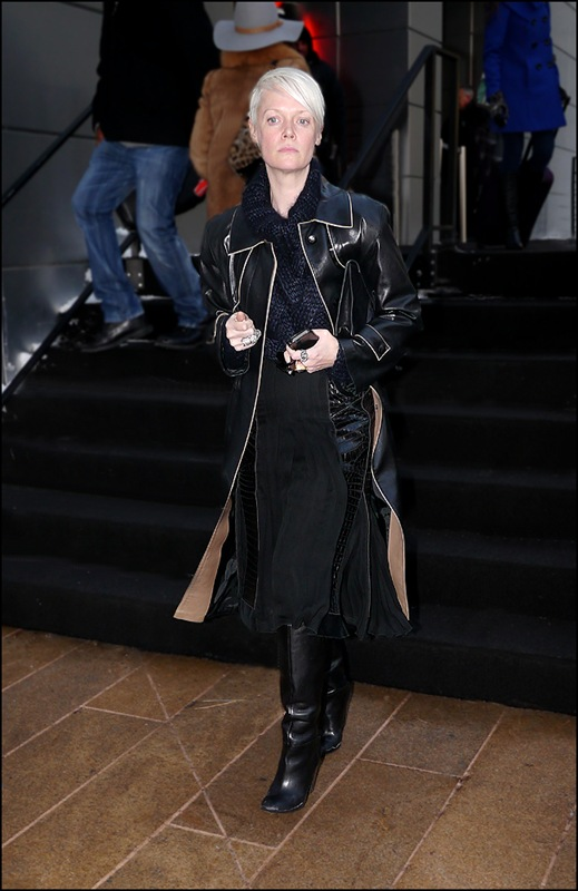 kate lanphear long black leather coat with piping long black skirt knit t nech black boots ol