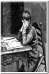 criança desanimada estudando
