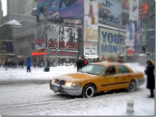yellow-cab-nyc-times-square-snow