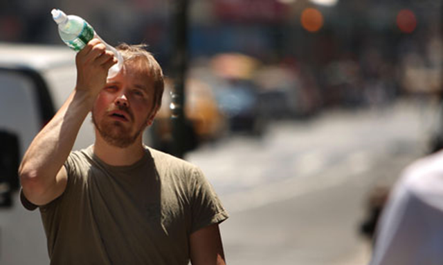 A man tries to cool himself with a bottle of water during the a heatwave in New York City. Photo: Spencer Platt / Getty Images