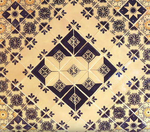 Polished Talavera tiles in a classic trio of navy, white and yellow.