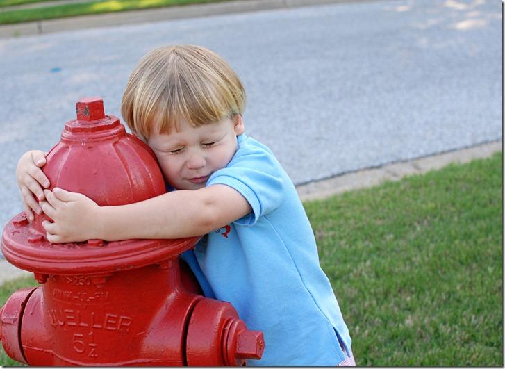 troy hugging fire hydrant