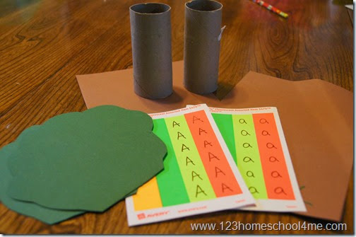 all you need is 2 toilet paper rolls, green & brown construciton paper, and circle stickers