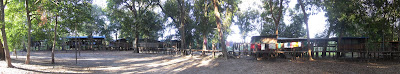 Multi-shot panorama of our campsite. Our cabin was off to the left, roughly in the middle was the kitchen and dinning area with the campfire in front of it and the place behind the washing line was the bar with the river just past it.
