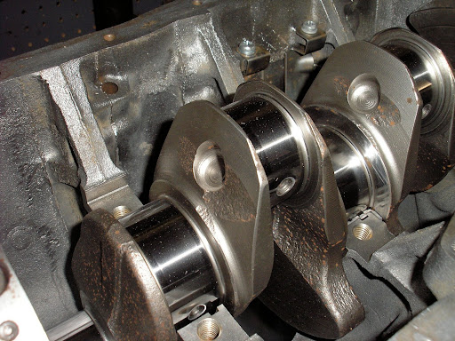 Datsun / Nissan Z22-L20B lightened, balanced and stroked crankshaft being mocked up in the block to check for proper clearance. YES, the moisture rust spots were removed before final install