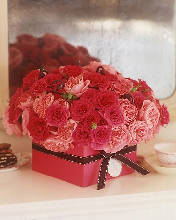 Roses in a ribbon box make a beautiful hostess gift.