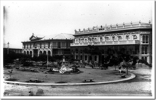 Hotel de Oriente (left) and La Insular Cigar and Cigarette Factory (right) in the early 1900s