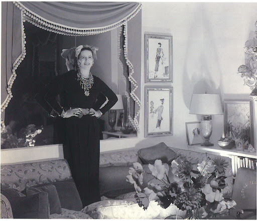 Diana Vreeland in her Park Avenue apartment.  I love her playful personal style, the curtain-framed mirror, the framed Bébé Bérard drawings, and the fact that she doesn't take her living space too seriously (notice she's standing atop her sofa).