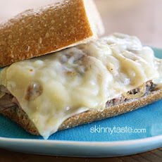 Roast Beef Sandwich with Melted Cheese and Caramelized Onions