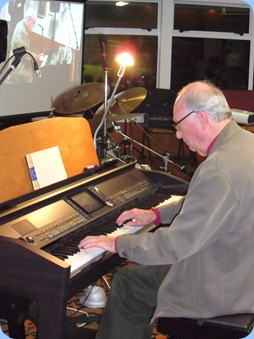 "Our former President, George Watt, strutting his stuff on the Clavinova. George played two great medleys for us. Just loved his arrangement of 'Wooden Heart""."
