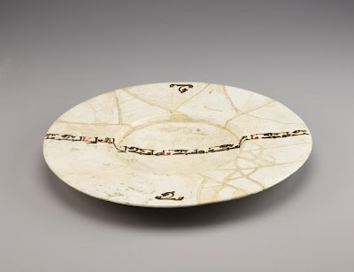 Dish | Origin:  Iran | Period: 10th century  Samanid period | Details:  Not Available | Type: Earthenware painted over glaze | Size: H: 5.0  W: 42.7  cm | Museum Code: F1954.16 | Photograph and description taken from Freer and the Sackler (Smithsonian) Museums.