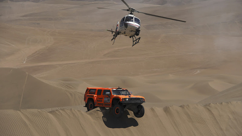 Hummer driver Robby Gordon and co-driver Johnny Campbell, both of the U.S., compete in the 10th stage of the 2012 Argentina-Chile-Peru Dakar Rally between Iquique and Arica, Chile, Wednesday Jan. 11, 2012. (AP Photo/Jerome Prevost, Pool)