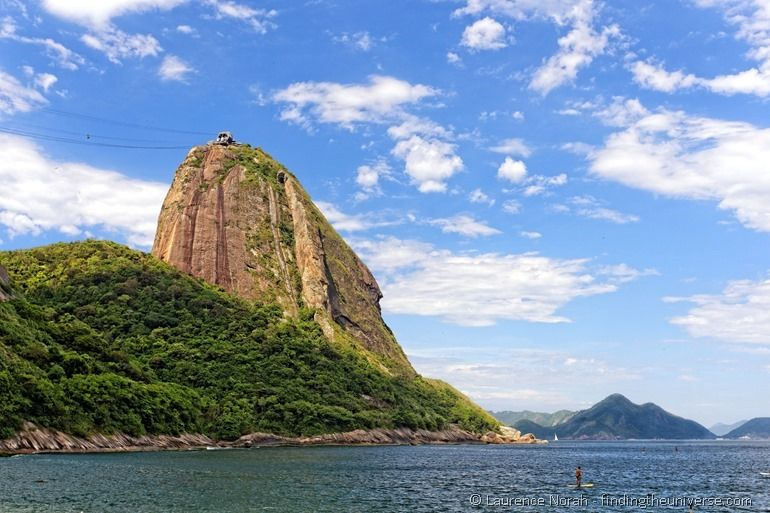 Paddle boarder by Sugarloaf Mountain Rio Brazil