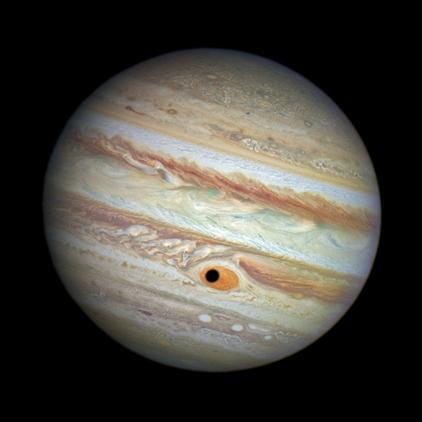 sombra de Ganimedes sobre a grande mancha de Júpiter