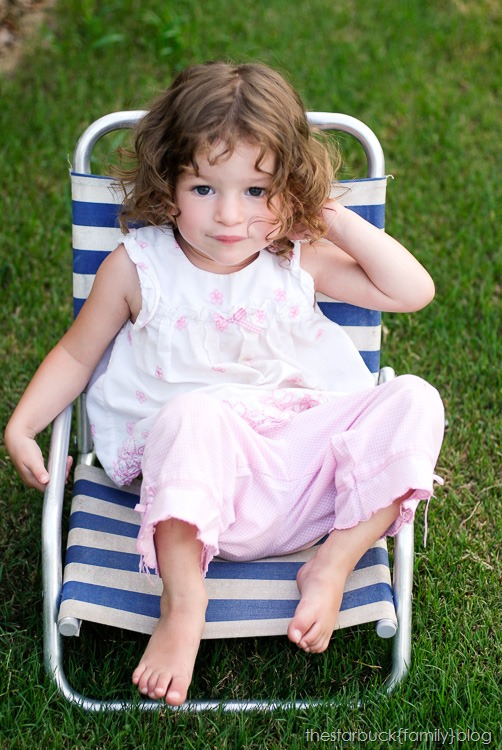 Abby playing with lawn chair and in carport blog-9