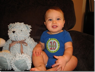 5.  Knox smiling with bear 10 months