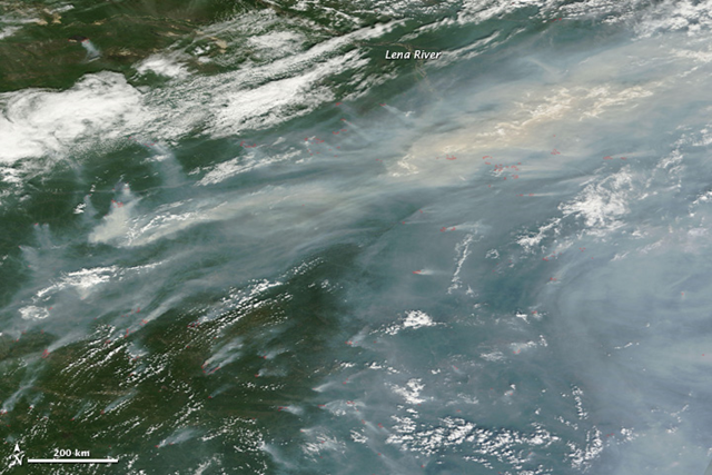 A thick curtain of smoke hangs over the forests of Siberia in this natural color image taken by the Moderate Resolution Imaging Spectroradiometer (MODIS) on the Terra satellite on 18 July 2011. Photo: NASA image courtesy the MODIS Rapid Response Team at NASA GSFC.