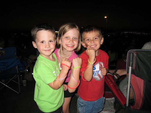 Eli, Natalie, and Aiden showing off their glow bands of POWER!