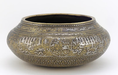 Bowl | Origin:  Iran | Period: early 14th century | Details:  Not Available | Type: Brass, inlaid with silver, gold and a black organic material | Size: H: 7.2  W: 16.6   D: 16.6  cm | Museum Code: F1949.11 | Photograph and description taken from Freer and the Sackler (Smithsonian) Museums.