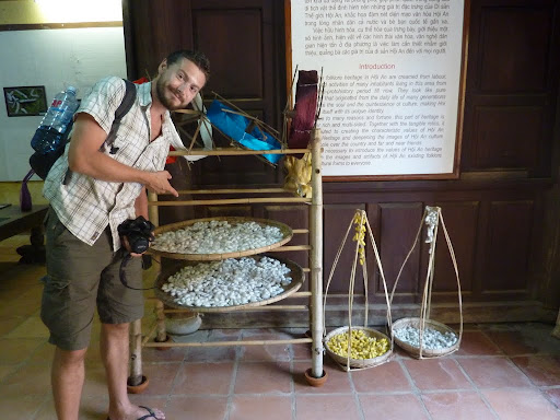 Me carefully examining repurposed Silk Worm cocoons, a strange musty smell around the place.