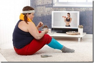 12472243-fat-woman-sitting-on-floor-with-chocolate-cake-while-watching-fitness-program-on-television_thumb[1]