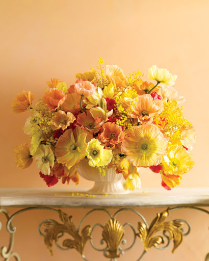 The orange colors in this flower arrangement remind me of a refreshing sherbet. (Martha Stewart Living)