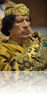 220px-Muammar_al-Gaddafi_at_the_AU_summit