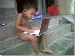cute_funny_kid_with_laptop_without_dress