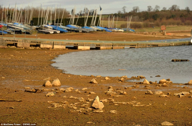 Low water levels at the Pitsford Resevoir in Northamptonshire, February 2012, show how successive winter droughts look set to cause water shortages for householders in many parts of the UK. Matthew Power / SWNS.com  via dailymail.co.uk