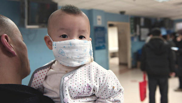 Chinese parents with children suffering from respiratory ailments, possibly caused by air pollution, flock to the Capital Institute of Pediatrics in Beijing. Gilles Sabrie for The New York Times