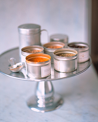 Keep all of the spices you need on hand next to the stove or a prep area with a cake stand.