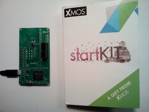 XMOS StartKIT board and its shipping box.