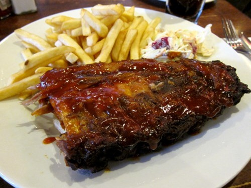 Mini Revolution: half rack of ribs & fries, chunky apple coleslaw and 1 free drink