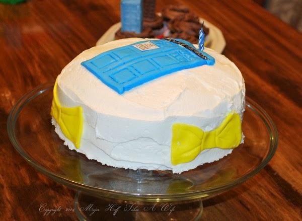 Bowties on side of Tardis cake